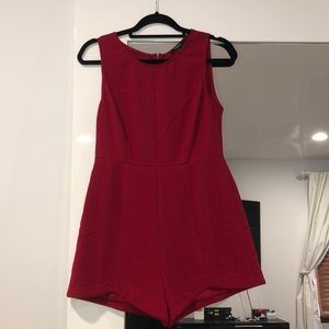 Red forever 21 romper with scalloped leg detail